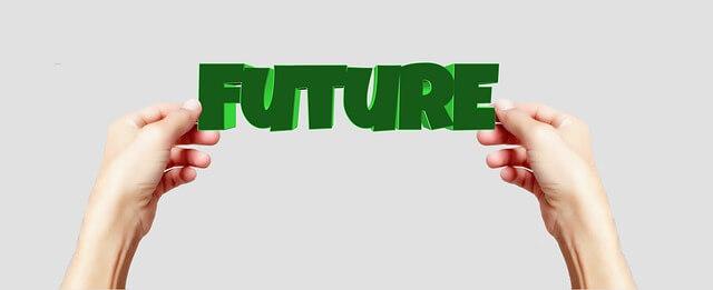 FUTUREの文字を持つ手