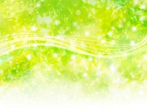 明るい緑の背景にキラキラした光