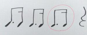 「タッカ」の音符と4分休符